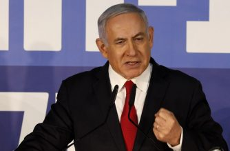"""Israeli Prime Minister Benjamin Netanyahu delivers a statement to the press on February 28, 2019, at his residency in Jerusalem. - Israel's attorney general announced today he intended to indict the prime minister on charges of bribery, fraud and breach of trust in a decision just weeks ahead of April elections. Netanyahu called the allegations a """"witch hunt"""" meant to topple him after the attorney general announced plans to indict him. (Photo by Gali TIBBON / AFP)"""
