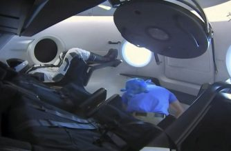 "This video grab taken from NASA TV on March 3, 2019, shows a dummy(L) named Ripley onboard a SpaceX Falcon 9 rocket with the company's Crew Dragon spacecraft onboard after the opening of the hatch during the Demo-1 mission. - SpaceX's new Dragon capsule successfully docked on the International Space Station on Sunday, NASA and SpaceX confirmed during a live broadcast of the mission.""We can confirm hard capture is complete,"" NASA said. The announcement was met with applause at the Johnson Space Center in Houston, Texas. (Photo by HO / NASA TV / AFP) / RESTRICTED TO EDITORIAL USE - MANDATORY CREDIT ""NASA TV/HANDOUT"" - NO MARKETING NO ADVERTISING CAMPAIGNS - DISTRIBUTED AS A SERVICE TO CLIENTS ---"