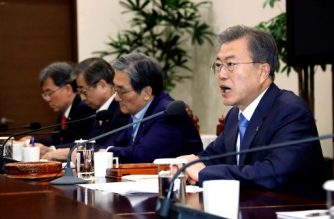 South Korean President Moon Jae-In (R) presides over a meeting of the National Security Council at the presidential Blue House in Seoul on March 4, 2019. - Moon on March 4 urged the US and North Korea to quickly resume denuclearisation talks after their Hanoi summit last week ended without a deal. (Photo by YONHAP / YONHAP / AFP) / - South Korea OUT / REPUBLIC OF KOREA OUT  NO ARCHIVES  RESTRICTED TO SUBSCRIPTION USE