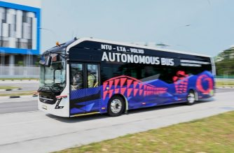 A Volvo AB 7300 electric autonomous bus drives on the track of Centre of Excellence for Testing & Research of Autonomous Vehicles after being unveiled in Singapore on March 5, 2019. (Photo by Roslan RAHMAN / AFP)