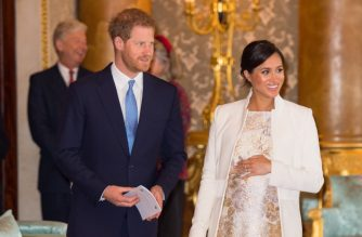 Britain's Prince Harry, Duke of Sussex, (L) and Britain's Meghan, Duchess of Sussex (R) attend a reception to mark the 50th Anniversary of the investiture of The Prince of Wales at Buckingham Palace in London on March 5, 2019. - The Queen hosted a reception to mark the Fiftieth Anniversary of the investiture of Britain's Prince Charles, her son, as the Prince of Wales. Prince Charles was created The Prince of Wales aged 9 on July 26th 1958 and was formally invested with the title by Her Majesty The Queen on July 1st 1969 at Caernarfon Castle. (Photo by Dominic Lipinski / POOL / AFP)