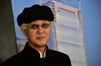 "(FILES) In this file photo taken on October 29, 2014 Japanese architect Arata Isozaki poses before a press conference at the ""City Life office Tower"", a skyscraper that was under construction in Milan. - Japanese architect Arata Isozaki has been awarded the Pritzker Prize, considered architecture's highest honor, for a lifetime of work that found global resonance while mining local traditions. ""Isozaki is a pioneer in understanding that the need for architecture is both global and local -- that those two forces are part of a single challenge,"" the chair of the jury, US Justice Stephen Breyer, said as the prize was announced on March 5, 2019. (Photo by Giuseppe CACACE / AFP)"