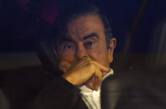 Former Nissan chairman Carlos Ghosn leaves his lawyers' offices after he was released earlier in the day from a detention centre after posting bail in Tokyo on March 6, 2019. - Former Nissan chief Carlos Ghosn left his Tokyo detention centre on March 6 after more than 100 days in custody, following a shock court decision granting him bail of one billion yen ($9 million). (Photo by Kazuhiro NOGI / AFP)