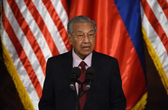 "Malaysia's Prime Minister Mahathir Mohamad speaks during his joint statement with Philippines' President Rodrigo Duterte at the Malacanang Palace in Manila on March 7, 2019. - Malaysian Prime Minister Mahathir Mohamad on March 7 warned the Philippines against letting in foreigners who could ""disturb"" the country's domestic political stability, as President Rodrigo Duterte's Beijing pivot sparks an influx of Chinese workers. (Photo by Ted ALJIBE / AFP)"