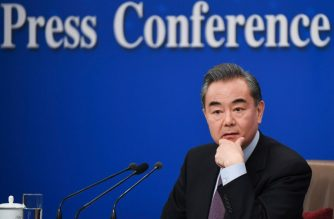 "China's Foreign Minister Wang Yi listens during a National People's Congress press conference in Beijing on March 8, 2019. - China threw its weight behind Huawei's legal battle against the United States on March 8, vowing to take all necessary measures to defend the ""legitimate rights"" of Chinese companies and individuals. (Photo by WANG ZHAO / AFP)"