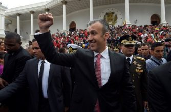 "(FILES) In this file photo taken on July 5, 2017, Venezuelan Vice-President Tareck El Aissami leaves an Independence Day ceremony at the National Assembly building in Caracas. - The US indicted Tareck El Aissami on sanctions violations on March 8, 2019, two years after naming him a narcotics ""kingpin"" for allegedly giving cover to drug traffickers. (Photo by Juan BARRETO / AFP)"
