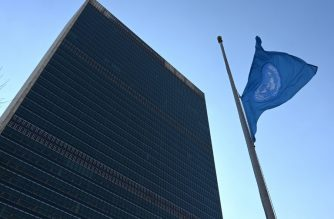 """The flag of the United Nations is flown at half-mast in front of the Secretariat building March 11, 2019, the morning after an Ethiopian Airlines Boeing 737 passenger jet to Nairobi crashed early on March 10, 2019 with 149 passengers and eight crew members aboard with no survivors. - No other flags will be flown when the UN flag is at half-mast.Flags flew at half-staff at the United Nations on Monday after 21 UN staff were killed in an Ethiopian Airlines plane crash that Secretary-General Antonio Guterres said marked a """"sad day"""" for the world body. (Photo by TIMOTHY A. CLARY / AFP)"""