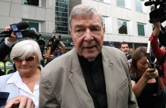 (FILES) In this file photo taken on February 26, 2019 Cardinal George Pell (C) leaves the County Court of Victoria court after prosecutors decided not to proceed with a second trial on alleged historical child sexual offences in Melbourne. - Disgraced Australian Cardinal Pell was sentenced to six years in jail for child sex crimes in a Melbourne court on March 13, 2019, with a non-parole period of three years and eight months. (Photo by Asanka Brendon Ratnayake / AFP)