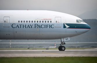 A Cathay Pacific passenger plane prepares to take off from Hong Kong's international airport on March 13, 2019. - Hong Kong flag carrier Cathay Pacific on March 13 announced a net profit of HK$2.35 billion ($299 million) last year, ending two successive annual losses after a massive overhaul. (Photo by Anthony WALLACE / AFP)
