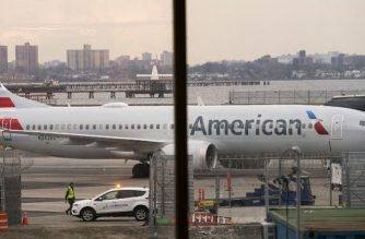 An American Airlines 737 Max sits at the gate at LaGuardia airport on March 13, 2019 in New York. - The ban on the Boeing 737 MAX aircraft became worldwide on Wednesday after US President Donald Trump joined Canada and other countries in grounding the aircraft amid intense pressure about the safety concerns. (Photo by Don Emmert / AFP)