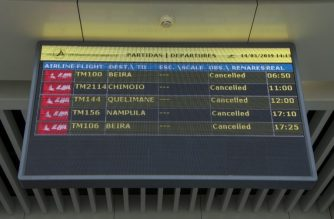 A Departures electronic panel indicating that all flights are cancelled is seen on March 14, 2019 at the Maputo International Airport in Mozambique. - Mozambique suspended all domestic flights as it is hit by the largest cyclone in decade. Dozens of flights scheduled to depart from Maputo's international airport, the largest in Mozambique, were left on land. Cyclone Idai, which hits the north and south of the country from Thursday, is the reason for flights cancellations. (Photo by EMIDIO JOSINE / AFP)