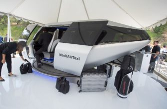 "(FILES) In this file photo taken on May 8, 2018 an attendee gets into a full sized model of Bell's unnamed air taxi cabin concept at the second annual Uber Elevate Summit, in Los Angeles, California. - We've all dreamed while stuck in traffic jams of being able to just lift off and fly over the gridlock. According to experts gathered this week at the South by Southwest festival in Austin, Texas, that is likely to happen sooner than later, with flying taxis expected to take to the skies by 2025.""People have been dreaming about it for decades on paper, and now the technology is here,"" said Michael Thacker, executive vice-president for technology and innovation at Bell. ""The only question is, what are we going to do with it?""Thacker said his company has joined with ride-hailing app Uber and several aeronautics firms, including France's Safran, to create a fleet of flying taxis that are called vertical take-off and landing vehicles (VTOL). (Photo by Robyn Beck / AFP)"