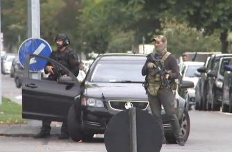 """An image grab from TV New Zealand taken on March 15, 2019 shows armed New Zealand special forces arriving outside the mosque following a shooting in Christchurch. - At least one gunman who targeted crowded mosques in the New Zealand city of Christchurch killed a number of people, police said, with Prime Minister Jacinda Ardern describing the shooting as """"one of New Zealand's darkest days"""". (Photo by Laurent FIEVET / TV New Zealand / AFP) / New Zealand OUT / XGTY----EDITORS NOTE ----RESTRICTED TO EDITORIAL USE MANDATORY CREDIT """" AFP PHOTO / TV New Zealand / NO MARKETING NO ADVERTISING CAMPAIGNS - DISTRIBUTED AS A SERVICE TO CLIENTS- NO ARCHIVE"""