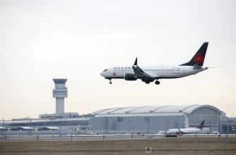 (FILES) In this file photo taken on March 13, 2019, an Air Canada Boeing 737 MAX 8 jet approaches Toronto Pearson International Airport in Toronto, Canada. - Boeing in the next 10 days will roll out an upgrade to the MCAS stall prevention system for 737 MAX aircraft that have had two deadly accidents in recent months, two industry sources told AFP. (Photo by Cole Burston / GETTY IMAGES NORTH AMERICA / AFP)