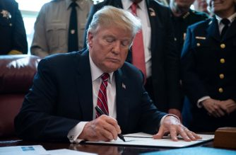 US President Donald Trump signs the first veto of his presidency, overriding a congressional resolution to secure emergency funds to build his much-vaunted wall on the US-Mexico border in the Oval Office at the White House in Washington, DC, on March 15, 2019. (Photo by NICHOLAS KAMM / AFP)