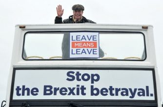 Former UK Independence Party leader and Brexit spearhead Nigel Farage poses on a pro-brexit campaign bus before the first leg of the March To Leave march in Sunderland on March 16, 2019. - Pro-Brexit campaigners are marching to London from northern England to coincide with Britain's anticipated departure from the EU on March 29. (Photo by Andy Buchanan / AFP)