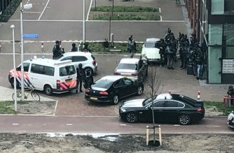 "In this handout picture from the twitter account of @michadrost, special police forces patrol in Utrecht after a shooting near the 24 Oktoberplace, on March 18, 2019. - Three people were killed and nine injured in a shooting in the Dutch city of Utrecht, the mayor said today, adding that authorities were working on the basis of it being a terrorist attack. Dutch police released a picture of Turkish-born Gokmen Tanis they are hunting over a shooting on a tram in Utrecht today. (Photo by @michadrost / various sources / AFP) / RESTRICTED TO EDITORIAL USE - MANDATORY CREDIT ""AFP PHOTO / Twitter / @michadrost"" - NO MARKETING NO ADVERTISING CAMPAIGNS - DISTRIBUTED AS A SERVICE TO CLIENTS --- NO ARCHIVE ---"