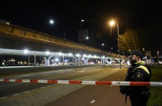 A policeman stands guard near the tram where a gunman opened fire killing at least three persons and wounding several in what officials said was a possible terror attack, on March 18, 2019 in Utrecht. - Dutch police arrested a Turkish-born suspect on March 18, after they had earlier launched a huge manhunt for Gokmen Tanis, 37, issuing a picture of him on the tram and warning the public not to approach him. (Photo by JOHN THYS / AFP)