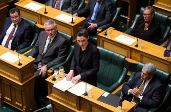 "New Zealand Prime Minister Jacinda Ardern (C) speaks at the Parliament Session as members of the parliament Grant Robertson (L), Kelvin Davis (2nd left) and Deputy PM Winston Peters (R) look on in Wellington on March 19, 2019. - Ardern vowed never to utter the name of the twin-mosque gunman as she opened a sombre session of parliament with an evocative ""as salaam alaikum"" message of peace to Muslims. (Photo by Dave Lintott / AFP)"