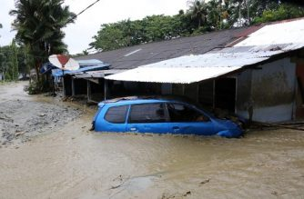 "This handout picture taken and released by Indonesia's Badan Nasional Penanggulangan Bencana (BNPB), the accident mitigation agency, on March 19, 2019 shows a flooded area in Sentani. - At least 89 people have died after flash floods and landslides tore through communities in Indonesia's Papua region, with rescuers hunting for dozens still missing, the disaster agency said. (Photo by Handout / BADAN NASIONAL PENANGGULANGAN BENCANA (BNBP) / AFP) / RESTRICTED TO EDITORIAL USE - MANDATORY CREDIT ""AFP PHOTO / BADAN NASIONAL PENANGGULANGAN BENCANA (BNBP)"" - NO MARKETING NO ADVERTISING CAMPAIGNS - DISTRIBUTED AS A SERVICE TO CLIENTS"