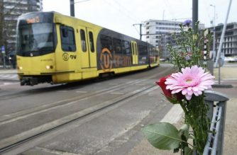Flowers have been set up in tribute to victims at the site of a shooting in a tram, at 24 October square in Utrecht, on March 19, 2019, one day after three people were shot dead and several were injured in the attack - Dutch police on March 18 arrested a Turkish-born suspect over a shooting on a tram in Utrecht that left three people dead in what officials said was a possible terror attack. (Photo by JOHN THYS / AFP)