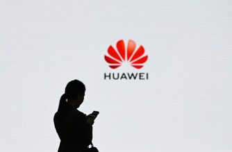 (FILES) In this file photo taken on March 06, 2019 A staff member of Huawei uses her mobile phone at the Huawei Digital Transformation Showcase in Shenzhen, China's Guangdong province on March 6, 2019. - Germany launched its auction on March 19, 2019 for the construction of an ultra-fast 5G mobile network as a transatlantic dispute rages over security concerns surrounding giant Chinese telecoms equipment maker Huawei. (Photo by WANG ZHAO / AFP)