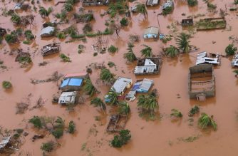 A picture shows houses in a flooded area of Buzi, central Mozambique, on March 20, 2019, after the passage of cyclone Idai. - International aid agencies raced on March 20 to rescue survivors and meet spiralling humanitarian needs in three impoverished countries battered by one of the worst storms to hit southern Africa in decades. Five days after tropical cyclone Idai cut a swathe through Mozambique, Zimbabwe and Malawi, the confirmed death toll stood at more than 300 and hundreds of thousands of lives were at risk, officials said. (Photo by ADRIEN BARBIER / AFP)