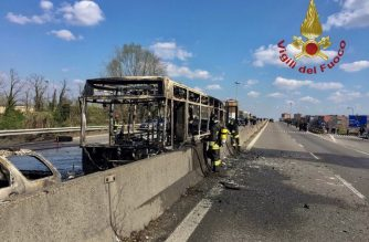 """This handout picture taken and released by the Vigili del Fuoco, the Italian fire and rescue service, on March 20, 2019 shows the wreckage of a school bus that was transporting some 50 children after it was torched by the bus' driver, in San Donato Milanese, southeast of Milan. - Italian police rescued some 50 children on March 20, 2019 after their driver threatened to torch their school bus which he doused with petrol, the authorities said. """"It is a miracle, it could have been carnage. The police were outstanding, blocking the bus and getting the children off,"""" said Milan prosecutor Francesco Greco, who added that he could not rule out a terrorist connection. (Photo by Handout / Vigili del Fuoco / AFP) / RESTRICTED TO EDITORIAL USE - MANDATORY CREDIT """"AFP PHOTO / VIGILI DEL FUOCO"""" - NO MARKETING NO ADVERTISING CAMPAIGNS - DISTRIBUTED AS A SERVICE TO CLIENTS ---"""