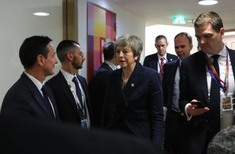 British Prime Minister Theresa May (C) leaves her office during a break on March 21, 2019, on the first day of an EU summit focused on Brexit, in Brussels. - European Union leaders meet in Brussels on March 21 and 22, for the last EU summit before Britain's scheduled exit of the union. (Photo by Ludovic MARIN / AFP)