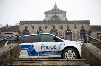 Police provide security at Saint Joseph's Oratory in Montreal on March 22, 2019, after Catholic Priest Claude Grou was stabbed during a livestreamed morning mass. - The suspect was arrested at the Roman Catholic basilica shortly after the attack in front of 50 people and a television audience around 8:40 am (1240 GMT), while Grou was taken to hospital. (Photo by Sebastien St-Jean / AFP)