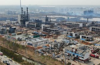 An aerial view shows a chemical plant after an explosion in Yancheng in China's eastern Jiangsu province, on March 23, 2019. - The death toll in a chemical plant explosion in China rose to 64 on March 23 but rescuers found a survivor among more than two dozen still missing in the debris of one of the country's worst industrial accidents in recent years. (Photo by STR / AFP) / China OUT