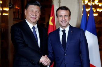 French President Emmanuel Macron (R) shakes hand with China's President Xi Jinping (L) at the Villa Kerylos before a dinner on March 24, 2019 in Beaulieu-sur-Mer, near Nice on the French riviera. (Photo by JEAN-PAUL PELISSIER / POOL / AFP)