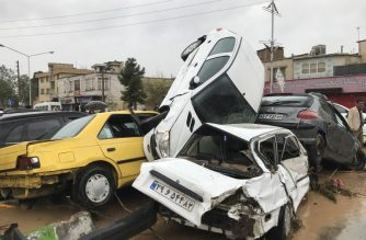 "An image made available by Iran's Mehr News agency on March 25, 2019, shows cars pilling up in a street in the southern city of Shiraz. - At least 12 people were killed and 45 injured in floods that swept across most Iranian provinces, the country's emergency services said. (Photo by AMIN BERENJKAR / MEHR NEWS / AFP) / ""The erroneous byline[s] appearing in the metadata of this photo by OMID BERANJKAR has been modified in AFP systems in the following manner: [AMIN BERENJKAR ] instead of [OMID BERANJKAR]. Please immediately remove the erroneous mention[s] from all your online services and delete it (them) from your servers. If you have been authorized by AFP to distribute it (them) to third parties, please ensure that the same actions are carried out by them. Failure to promptly comply with these instructions will entail liability on your part for any continued or post notification usage. Therefore we thank you very much for all your attention and prompt action. We are sorry for the inconvenience this notification may cause and remain at your disposal for any further information you may require."""
