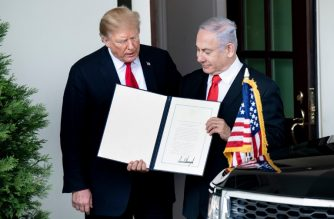 """US President Donald Trump (L) and Israel's Prime Minister Benjamin Netanyahu hold up a Golan Heights proclamation outside the West Wing after a meeting in the the White House March 25, 2019 in Washington, DC. - US President Donald Trump on Monday signed a proclamation recognizing Israeli sovereignty over the disputed Golan Heights, a border area seized from Syria in 1967. """"This was a long time in the making,"""" Trump said alongside Israeli Prime Minister Benjamin Netanyahu in the White House. US recognition for Israeli control over the territory breaks with decades of international consensus. (Photo by Brendan Smialowski / AFP)"""