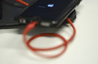 "(FILES) In this file photo taken on March 18, 2019 An iPhone 6S is plugged into a battery charger on March 18, 2019 in Washington,DC. - An International Trade Commission judge on March 26, 2019, ruled that Apple violated a Qualcomm chipmaker patent and said she will recommended banning imports of some iPhone models. ""I will be recommending that a limited exclusion order together with a cease and desist order, both with certification provisions, issue against Apple,"" ITC administrative law judge MaryJoan McNamara wrote in a ruling. (Photo by Brendan Smialowski / AFP)"