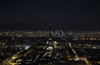 A picture taken on March 30, 2019 shows the Eiffel Tower, in Paris, switched-off during the a Earth Hour organised by the green group WWF. - Earth Hour is a global call to turn off lights for one hour in a bid to highlight the global climate change. (Photo by Geoffroy VAN DER HASSELT / AFP)