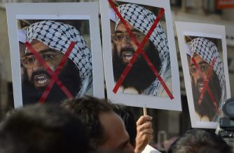 Indian activists carry placards of the chief of Jaish-e-Mohammad, Maulana Masood Azhar during a protest against the attack on the air force base in Pathankot, in Mumbai on January 4, 2016.  Indian troops backed by helicopters searched an air force base January 4, after a weekend of fierce fighting with suspected Islamic insurgents in which seven soldiers and at least four attackers were killed.    AFP PHOTO/ Indranil MUKHERJEE (Photo by INDRANIL MUKHERJEE / AFP)