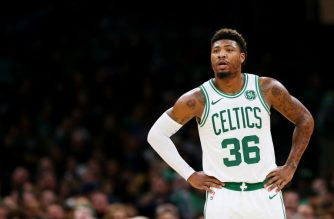 BOSTON, MA - DECEMBER 14: Marcus Smart #36 of the Boston Celtics looks on during the game between the Boston Celtics and the Atlanta Hawks at TD Garden on December 14, 2018 in Boston, Massachusetts.   Maddie Meyer/Getty Images/AFP