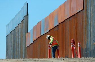 OTAY MESA, CA - FEBRUARY 22: Construction workers build a secondary border wall on February 22, 2019 in Otay Mesa, California. The Department of Homeland Security is building 12.5 miles of secondary border wall as part of Presient Donald Trump's Border Security and Immigration Enforcement Improvements Executive Order to build new fencing along the Southern Border.   Sandy Huffaker/Getty Images/AFP