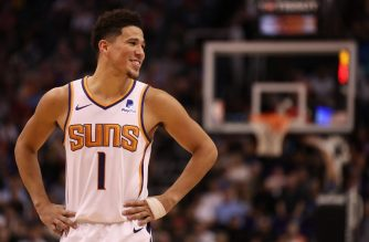 PHOENIX, ARIZONA - MARCH 04: Devin Booker #1 of the Phoenix Suns reacts during the second half of the NBA game against the Milwaukee Bucks at Talking Stick Resort Arena on March 04, 2019 in Phoenix, Arizona. The Suns defeated the Bucks 114-105.   Christian Petersen/Getty Images/AFP