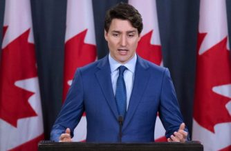 (FILES) In this file photo taken on March 07, 2019 Canadian Prime Minister Justin Trudeau speaks to the media at the national press gallery in Ottawa, Ontario. - A political meddling scandal threatening Prime Minister Justin Trudeau's re-election bid was given fresh impetus March, 29, 2019, with the release of messages and a secret recording supplied by his former attorney general. The House of Commons justice committee, looking into the explosive allegations that Trudeau officials pressured attorney general Jody Wilson-Raybould to shield engineering firm SNC-Lavalin from trial, released the materials from the now former official. (Photo by Lars Hagberg / AFP)