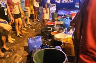 People line up even at night to fill their containers with much needed water at a water rationing provided by Manila Water Company in Mandaluyong City, one of the cities in Metro Manila affected by the Manila Water's water service interruption (Eagle News Service)