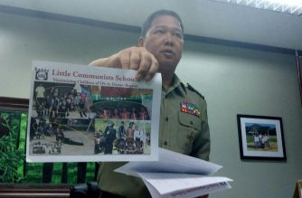 Armed Forces of the Philippines (AFP) Deputy chief of staff for civil military operations, J7, BGen. Antonio Parlade, presents some of the evidence allegedly linking some militant non-government groups to tbe communist movement, and the rebel group, New People's Army (NPA)