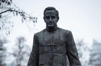 "A portion of a picture taken on December 6, 2018 in Gdansk shows a statue of late Father Henryk Jankowski covered with paint, a few days after the publication of testimonies of people accusing him of paedophilia. - Father Henryk Jankowski, former Catholic chaplain of Solidarity, had been the first free trade union of the communist bloc in the early 1980s, and died in 2010. The priest's hands and a piece of his cassock were stained with red paint while a candle was displayed in front of the statue with the inscription ""Ewa, 16 years old"", the first name of a possible victim of his actions. (Photo by Krzysztof MYSTKOWSKI / AFP)"