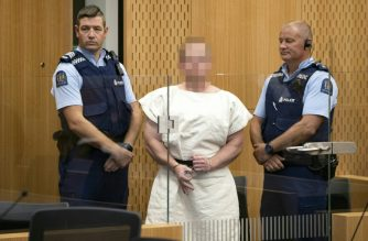Brenton Tarrant makes a white power sign during his court appearance./Mark Mitchell/AFP/