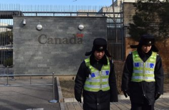 """Police patrol outside the Canadian embassy in Beijing on January 15, 2019. - A Chinese court sentenced a Canadian man to death on drug trafficking charges on January 14 after his previous 15-year prison sentence was deemed too lenient, deepening a diplomatic rift as Canadian premier Justin Trudeau accused Beijing of """"arbitrarily"""" using capital punishment. (Photo by GREG BAKER / AFP)"""