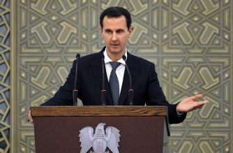 """A handout picture released by the official Syrian Arab News Agency (SANA) on February 17, 2019 shows shows President Bashar al-Assad delivering a speech at a meeting for the heads of local councils in the capital Damscus. (Photo by - / SANA / AFP) / == RESTRICTED TO EDITORIAL USE - MANDATORY CREDIT """"AFP PHOTO / HO / SANA"""" - NO MARKETING NO ADVERTISING CAMPAIGNS - DISTRIBUTED AS A SERVICE TO CLIENTS =="""