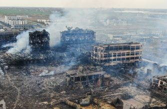 An aerial view shows damaged buildings after an explosion at a chemical plant in Yancheng in China's eastern Jiangsu province early on March 22, 2019. - Chinese President Xi Jinping ordered local governments on March 22 to prevent any more industrial disasters after a chemical plant blast left 47 people dead, injured hundreds and flattened an industrial park in the latest such catastrophe to hit the country. (Photo by STR / AFP) / China OUT
