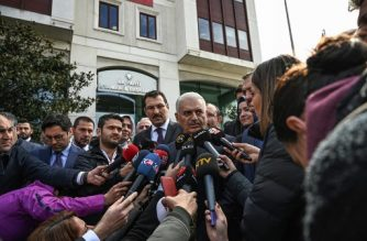Turkish ruling Justice and Development Party (AKP) Istanbul mayoral defeated candidate Binali Yildirim (R) speaks to medias as he arrives to the headquarters of the AKP on march 31, 2019 in Istanbul. - Turkish President ruling party suffered a major upset on Monday after local election results showed it lost the capital Ankara and Istanbul after a decade and half in power. (Photo by OZAN KOSE / AFP)