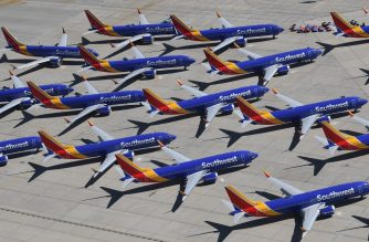 (FILES) In this file photo taken on March 28, 2019 Southwest Airlines Boeing 737 MAX aircraft are parked on the tarmac after being grounded, at the Southern California Logistics Airport in Victorville, California. - Boeing announced on April 5, 2019 it would cut the production schedule of its 737 aircraft line following the two recent crashes that have seen the 737 MAX grounded worldwide. (Photo by Mark RALSTON / AFP)